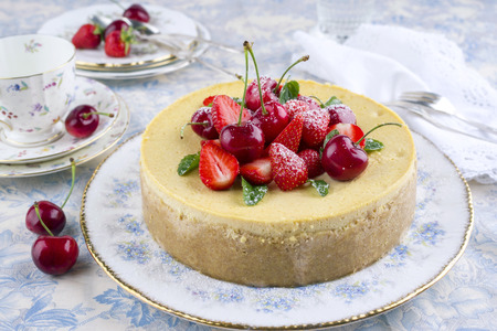 white backing: Cheesecake with Fruits Stock Photo