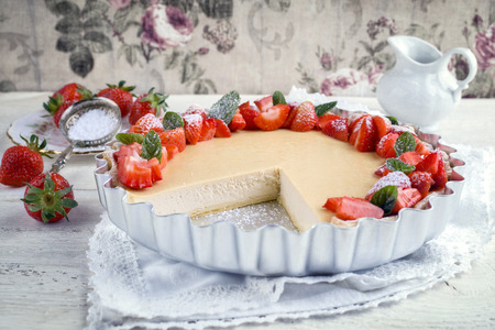 Cheesecake with strawberries in backing form Stock Photo