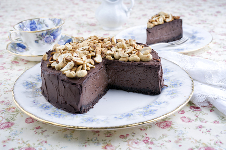 gold table cloth: Chocolate Pie with Nuts on Plate Stock Photo