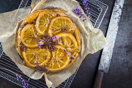 fruit background: Orange Pie on old Metal Sheet Stock Photo