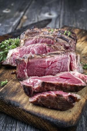 Barbecue rib eye steak sliced ??on cutting board
