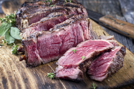 Barbecue Entrecote Steak sliced ??on Chopping Board