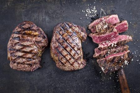 Barbecue Entrecote Steaks on old metal sheet Banco de Imagens - 71370440
