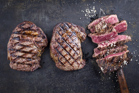 Barbecue Entrecote Steaks on old metal sheet