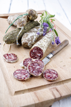 toskana: Salami on Chopping Board Stock Photo