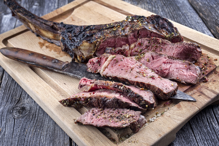 black angus cattle: Barbecue Tomahawk Steak on Cutting Board Stock Photo