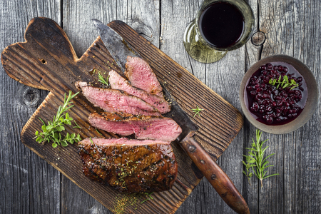Vanison steak on old cutting board Stock fotó - 71336498