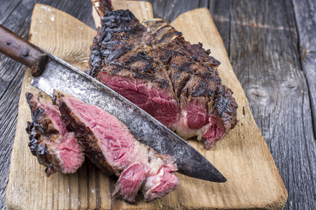 alt: Barbecue Tomahawk Steak on Cutting Board Stock Photo