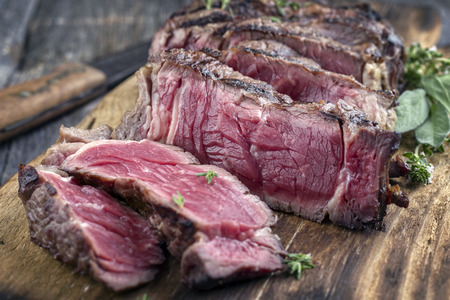 black angus cattle: Barbecue Entrecote Steak sliced ??on Chopping Board