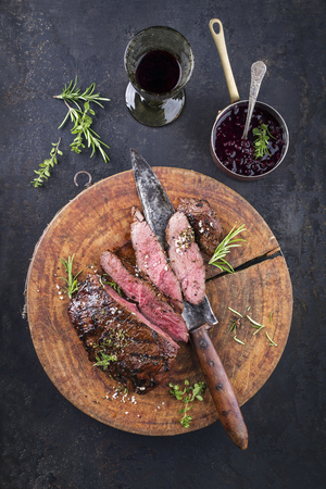 Barbecue Venison Steak on old cutting board