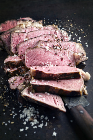 cattle grid: Barbecue Entrecote Steak sliced ??on old metal sheet Stock Photo