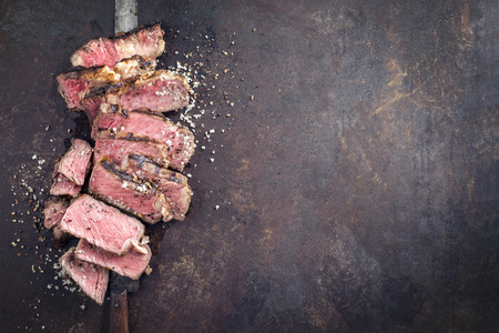 Barbecue Entrecote Steak sliced ??on old metal sheet Stock Photo