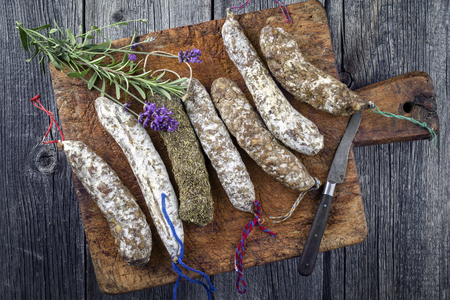longaniza: Salami on old cutting board