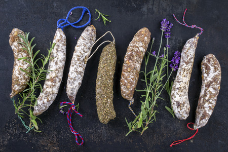 haut: Salami with herb on old Metall Sheet Stock Photo