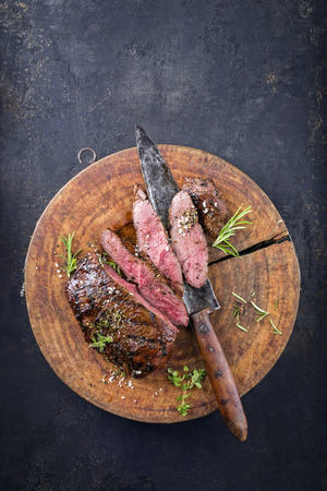 Venison Steak on old Cutting Board