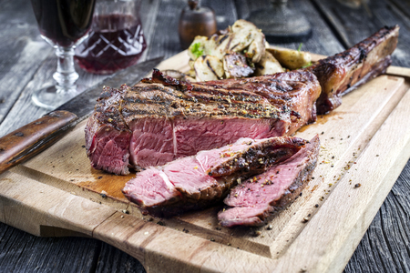 Barbecue Tomahawk Steak on Cutting Board Stock Photo