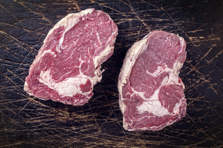 rumpsteak: Dry Aged Entrecote on old Wooden Board