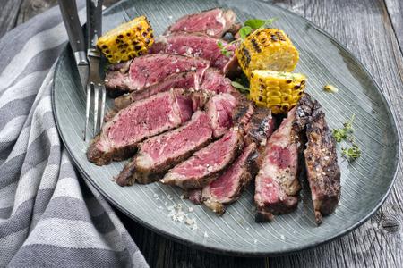 rib eye: Barbecue Rib Eye Steak sliced on Plate