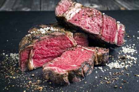 Barbecue dry aged Kobe rib eye steak as close-up on a black slate Stock fotó - 75063395