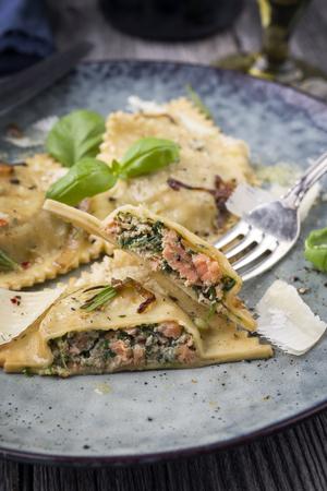 tortellini: Salmon Spinach Ravioli on Plate Stock Photo
