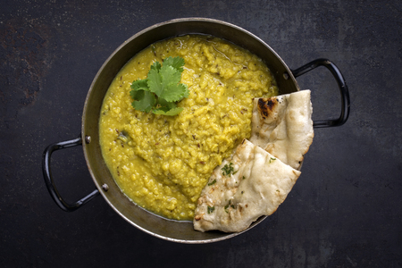 Indian Dal Soup with Naan Bread in Bowl Stock fotó