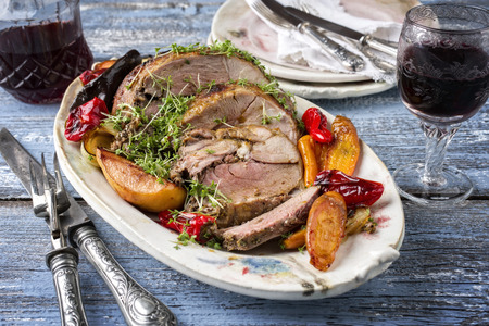 Leg of Lamb with Vegetables and Fruits Stock Photo