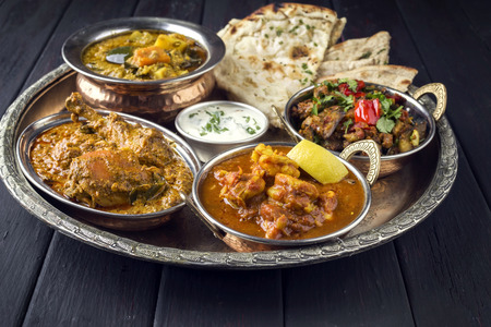 Indian Dished on traditional Thali Imagens