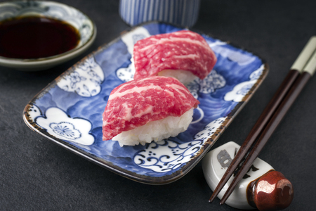 Traditional Japanese Wagyu Nigiri sushi as close-up on a bowl