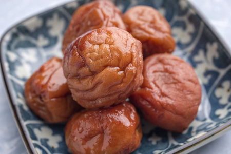 Traditional Japanese Umeboshi as close-up in a bowl