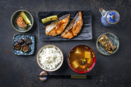 Traditional Japanese dish with fish teriyaki and soup as close-up in bowls