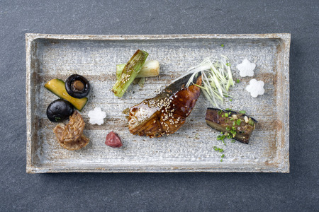 soja: Traditional Japanese dish with Fish Teriyaki and Vegetable as close-up on a tray Stock Photo