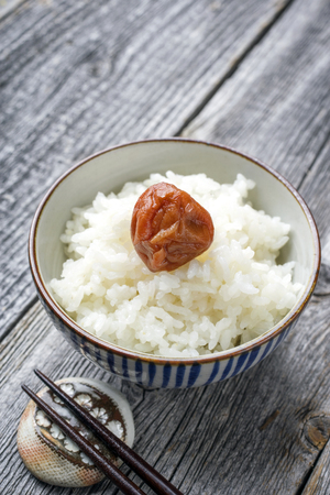 wei: Traditional Japanese Koshihikari Rice with Umeboshi as close-up in a bowl