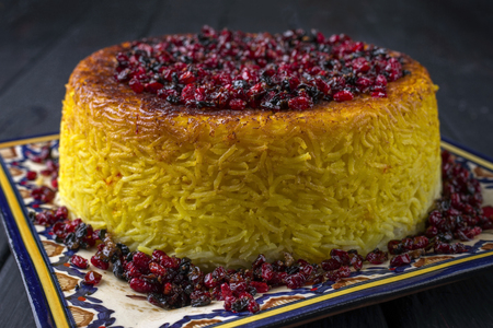 safran: Traditional Iranian Rice Pie Tahdig with Berberis on a plate