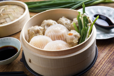 Traditional Chinese Dim Sum as close-up on Bamboo Steamer