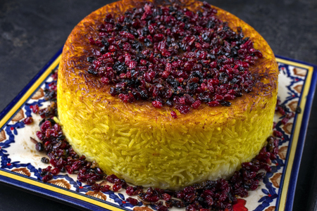 safran: Traditional Iranian Rice pie Tahdig Polo with Berberis on a plate