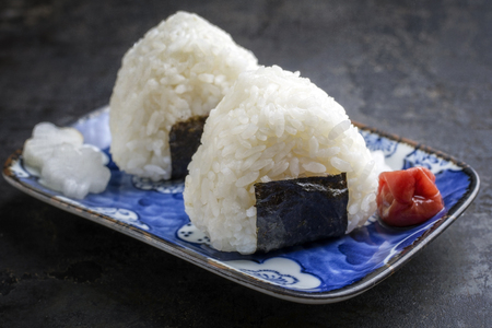 wei: Traditional Japanese Onigiri with Umeboshi as close-up on a bowl Stock Photo