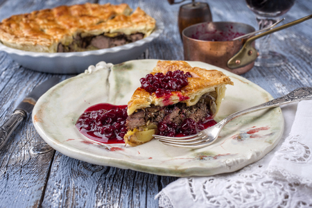 Venison Pie with Cranberry Relish as close-up on a plate