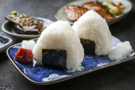 wei: Traditional Japanese Onigiri with Umeboshi as garnish on a bowl Stock Photo