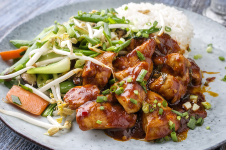 soja: Chicken sweet-sour with Vegetable and white Rice as close-up on a plate