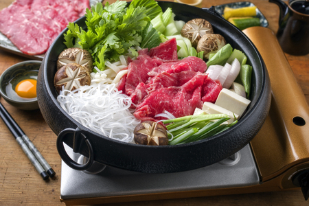 Traditional Japanese Sukiyaki with Kobe Beef as close-up in a pot Stock Photo