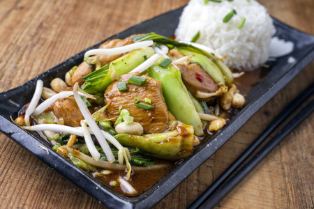 bok choy: Traditional Chicken Gung Bao with Vegetable as close-up on a plate