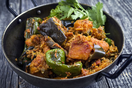 Indian Vegetable Curry Fry with Sweet Potatoes and Eggplant as close-up in a Korai Stock Photo