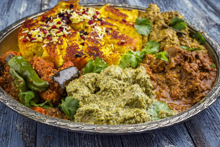 Traditional Indian Iranian Curries with Tahdig as close-up on a Thali