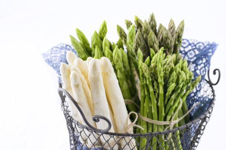 Green and White Asparagus in Basket - Isolated Stock Photo