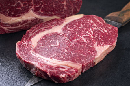 Raw dry aged kobe entrecote steak as close-up on a slate Stock fotó - 78669854