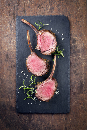 Rare Barbecue Rack of Venison on top of a black slate Stock Photo