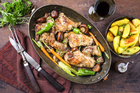 white wine: Rabbit with Vegetable and Mushrooms as top view in a Stewpot Stock Photo