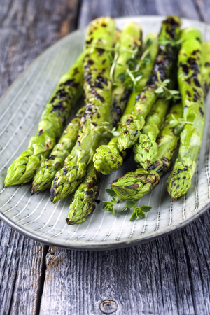 Barbecue green Asparagus as close-up on a plate