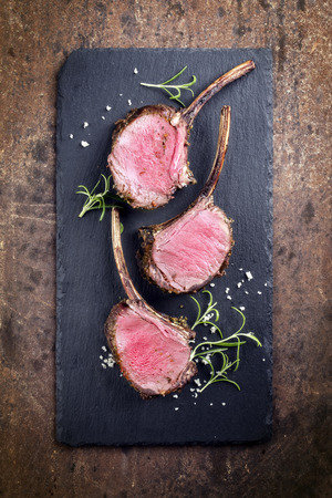 leger: Rare Barbecue Rack of Venison on top of a black slate Stock Photo