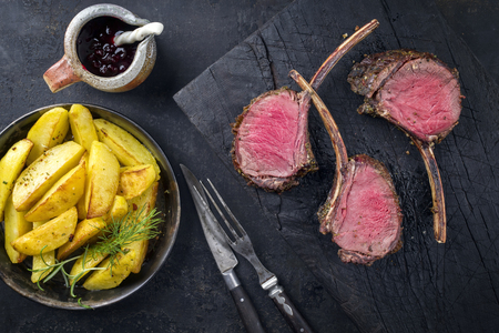 Barbecue rack of venison with potatoes and cranberries